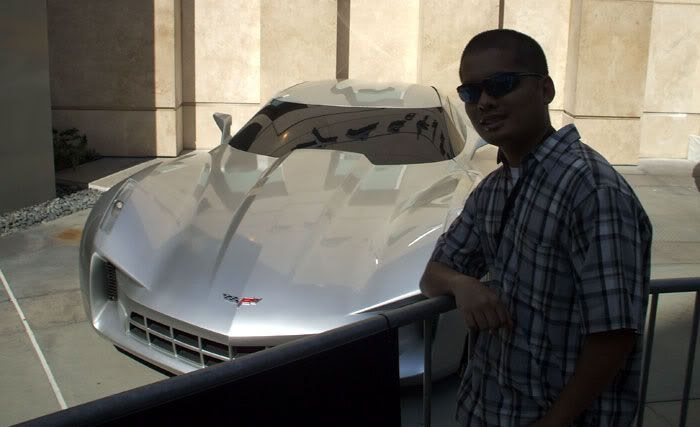 Posing in front of the Corvette Stingray that represents the Autobot known as Sideswipe in TRANSFORMERS 2.