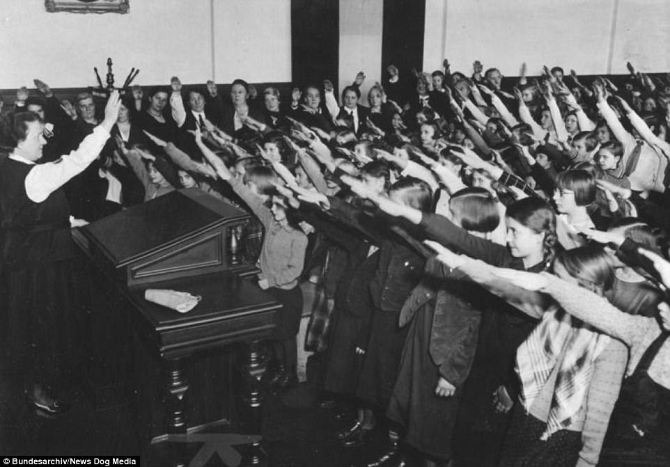 German children were indoctrinated on a daily basis and             forced to raise their arms and chant 'Heil Hitler'. Teachers             were forced to join the Nazi Party or face suspicion that             they were opposed to the regime