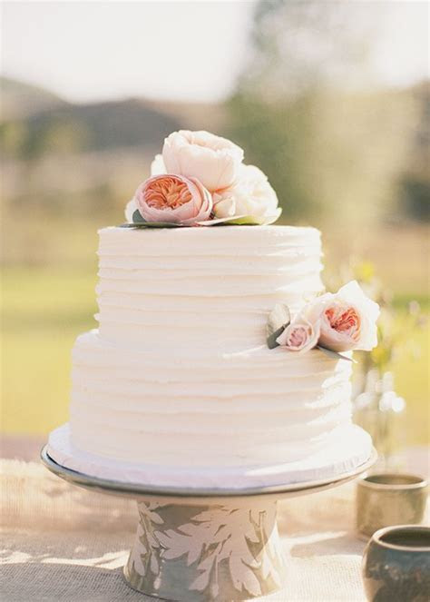 White two tier wedding cake with textured frosting and