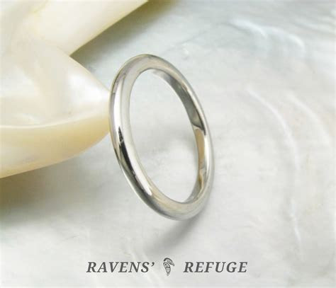 hand forged high dome wedding band ? platinum stacking