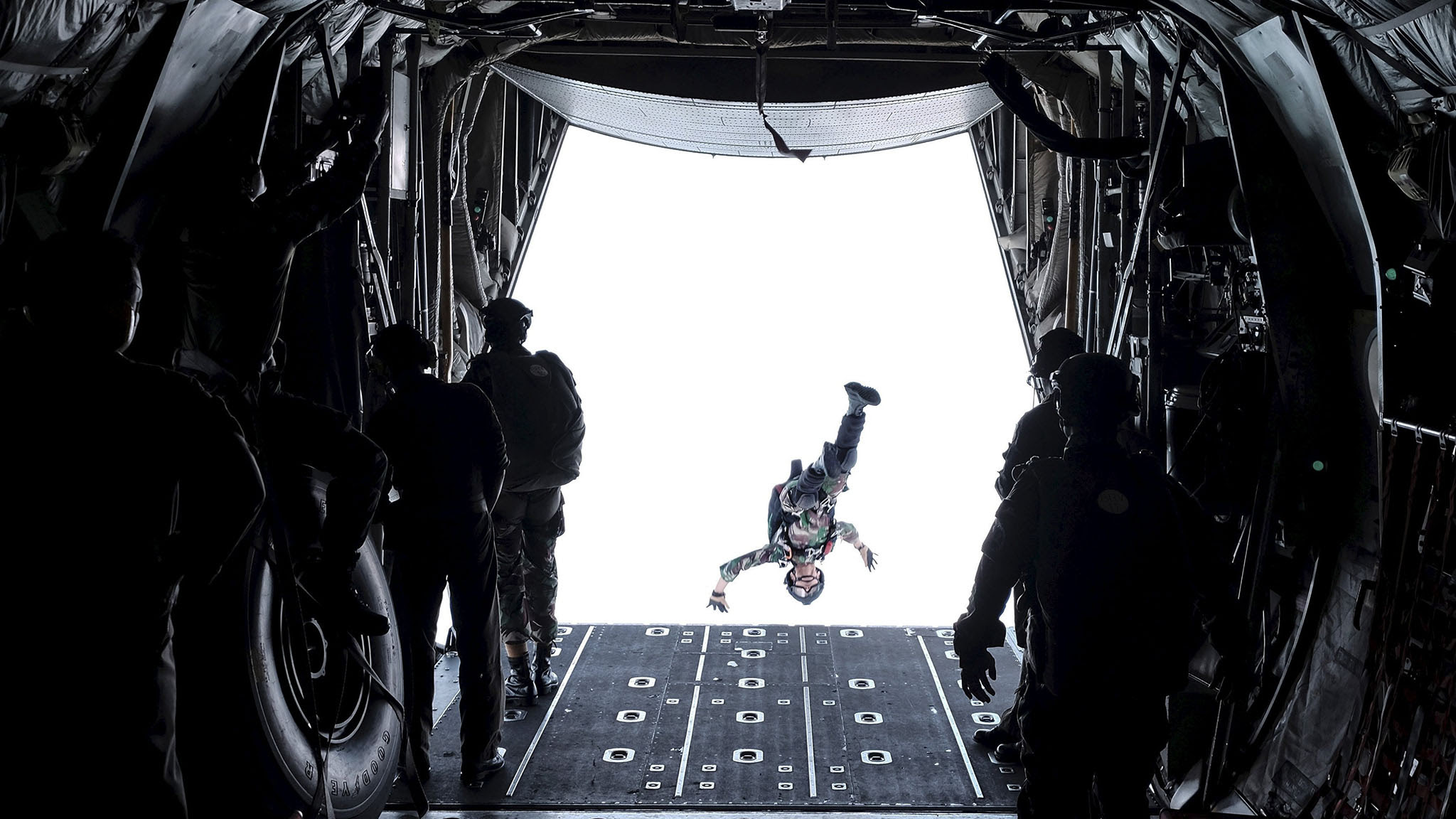 A soldier from Indonesia's Rapid Reaction Strike Force jumps out