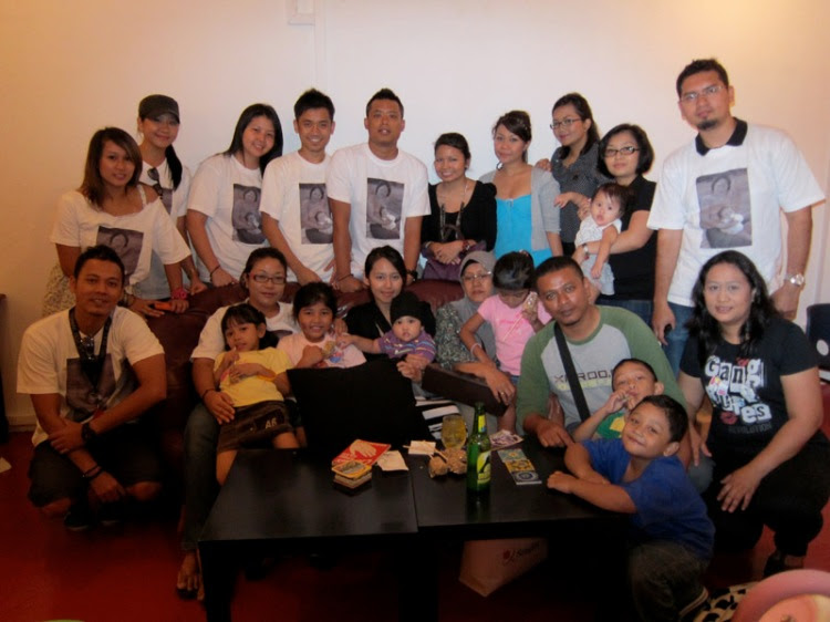 The Save Atiqah campaign committee with her family.