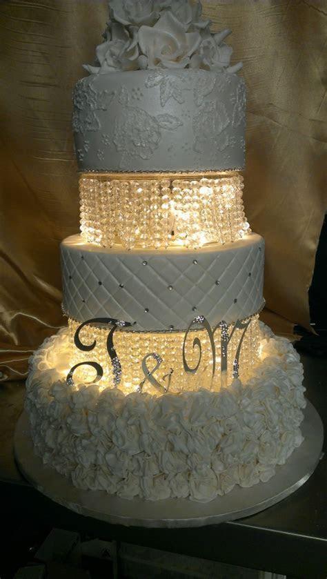 three tier round wedding cake white lights crystals lace