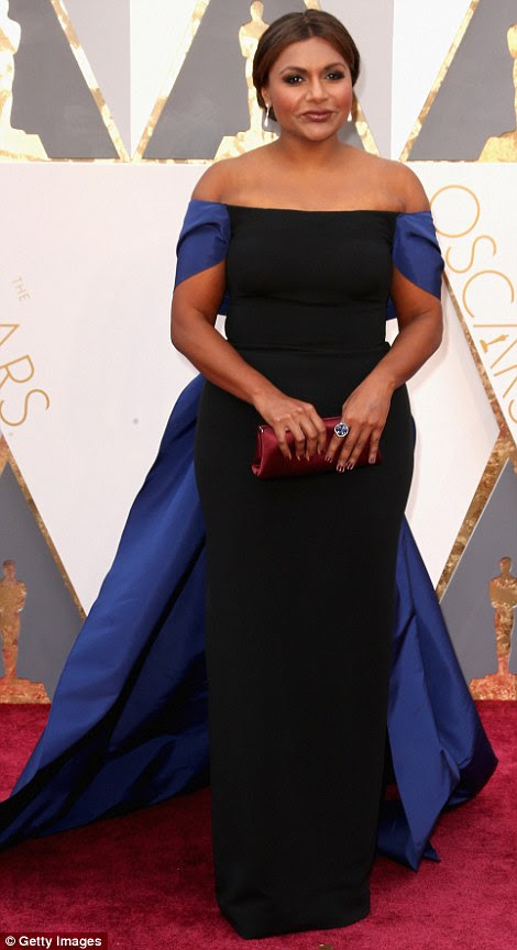 Oozing elegance: Mindy Kaling looked lovely in a black off-the-shoulder Elizabeth Kennedy dress with bright blue sleeves and train
