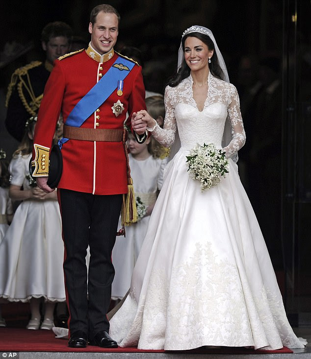 Just married! HRH Princess Catherine emerges from Westminster Abbey, wearing an Alexander McQueen dress, holding hands with her new husband Prince William