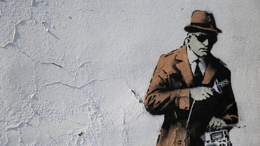 File photo - A detail from graffiti art is seen on a wall near the headquarters of Britain's eavesdropping agency, Government Communications Headquarters, known as GCHQ, in Cheltenham, western England April 16, 2014. (REUTERS/Eddie Keogh)