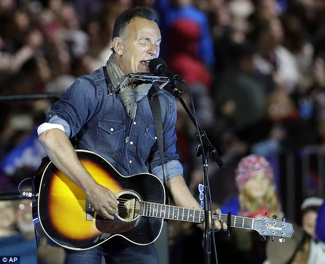 Clinton drew thousands of supporters, with help from both Barack and Michelle Obama, her husband Bill, daughter Chelsea and Bruce Springsteen, who warmed the crowd (pictured)