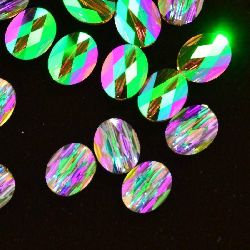 27750510066007 Swarovski Bead - 10 x 8 mm Mini-Oval (5051) - Crystal Paradise Shine (1)