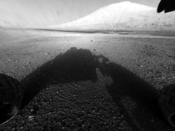 An image of Curiosity's shadow with Mount Sharp in the background...taken by one of the rover's hazard-avoidance cameras.