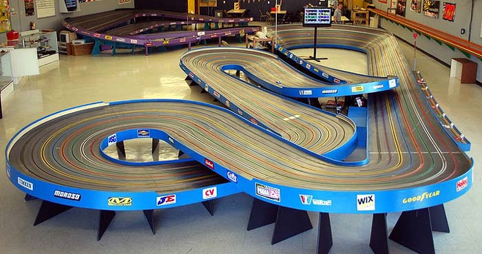 American Model Raceways created the original King track design in the early '60s.As you probably know, AMR color-coded the sides on their tracks and the King's color was blue, like the orange Monarch, red Imperial, black Regal, and the purple Sovereign.So an .