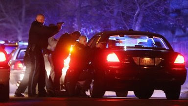 Police with guns drawn search for a suspect in Watertown, Massachusetts, on 19 April 2013