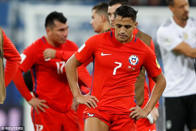 Alexis Sanchez looks on in frustration as his Chile side struggle to come to terms with defeat
