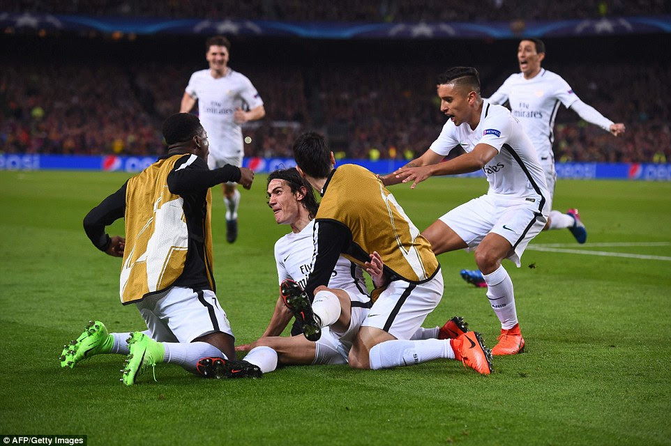 Cavani is joined in his celebrations by PSG's substitutes after seemingly sealing their place in the quarter-finals