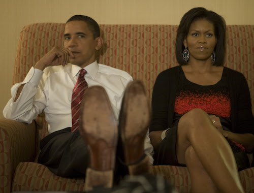 Barack Obama and Michelle Obama watching election returns