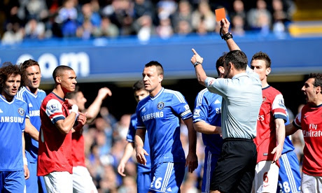 Arsenal's Kieran Gibbs is sent off by referee Andre Marriner against Chelsea in the Premier League