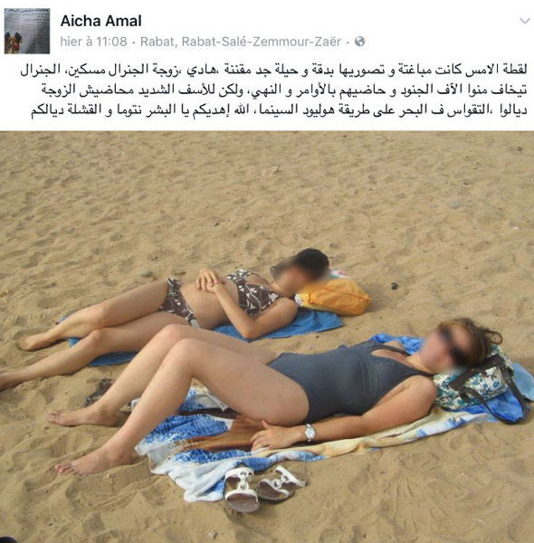 Women lie on a beach