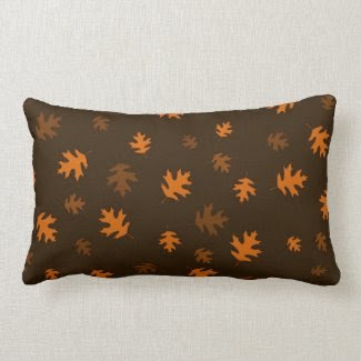 Orange Autumn Oak Leaves Against Dark Brown Pillow