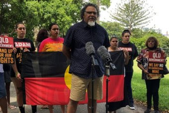 Adrian Burragubba from the W&J traditional owners holding a media conference, flanked by other W&J members