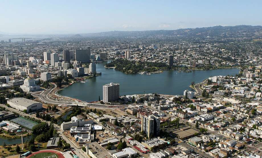 The Oakland skyline rises above Lake Merritt. Photo: Lance Iversen, The Chronicle
