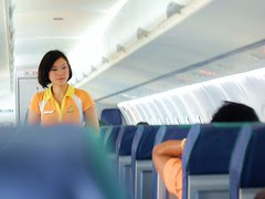 Cebu Pacific Flight Attendant on a half full f...