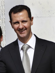 FILE - In this Oct. 21, 2010 file photo, Syrian President Bashar Assad smiles as he shakes hands with Venesuela's President Hugo Chafez, not seen, at the Syrian presidential palace, in Damascus, Syria. Assad said in an interview with Britain's Sunday Times newspaper published Sunday Nov. 20, 2011 that Syria will not bow and will continue to resist the pressures being imposed on it. (AP Photo/Hussein Malla, file)