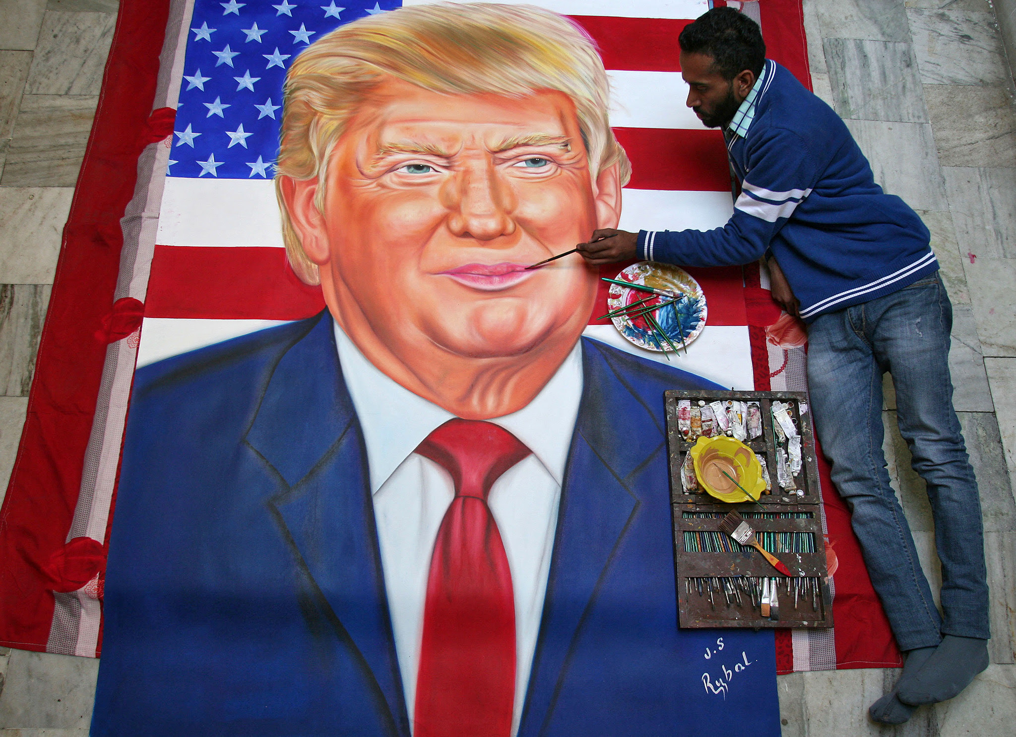 Jagjot Singh Rubal, an Indian artist, gives final touches to a portrait of U.S. President-elect Donald Trump ahead of Trump's inauguration at his workshop in Amritsar, India, January 19, 2017. REUTERS/Munish Sharma FOR EDITORIAL USE ONLY. NO RESALES. NO ARCHIVES.