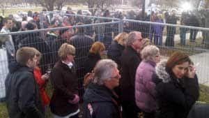 A crowd gathers outside the Frontenac County Court House in Kingston, Ont., on Sunday.
