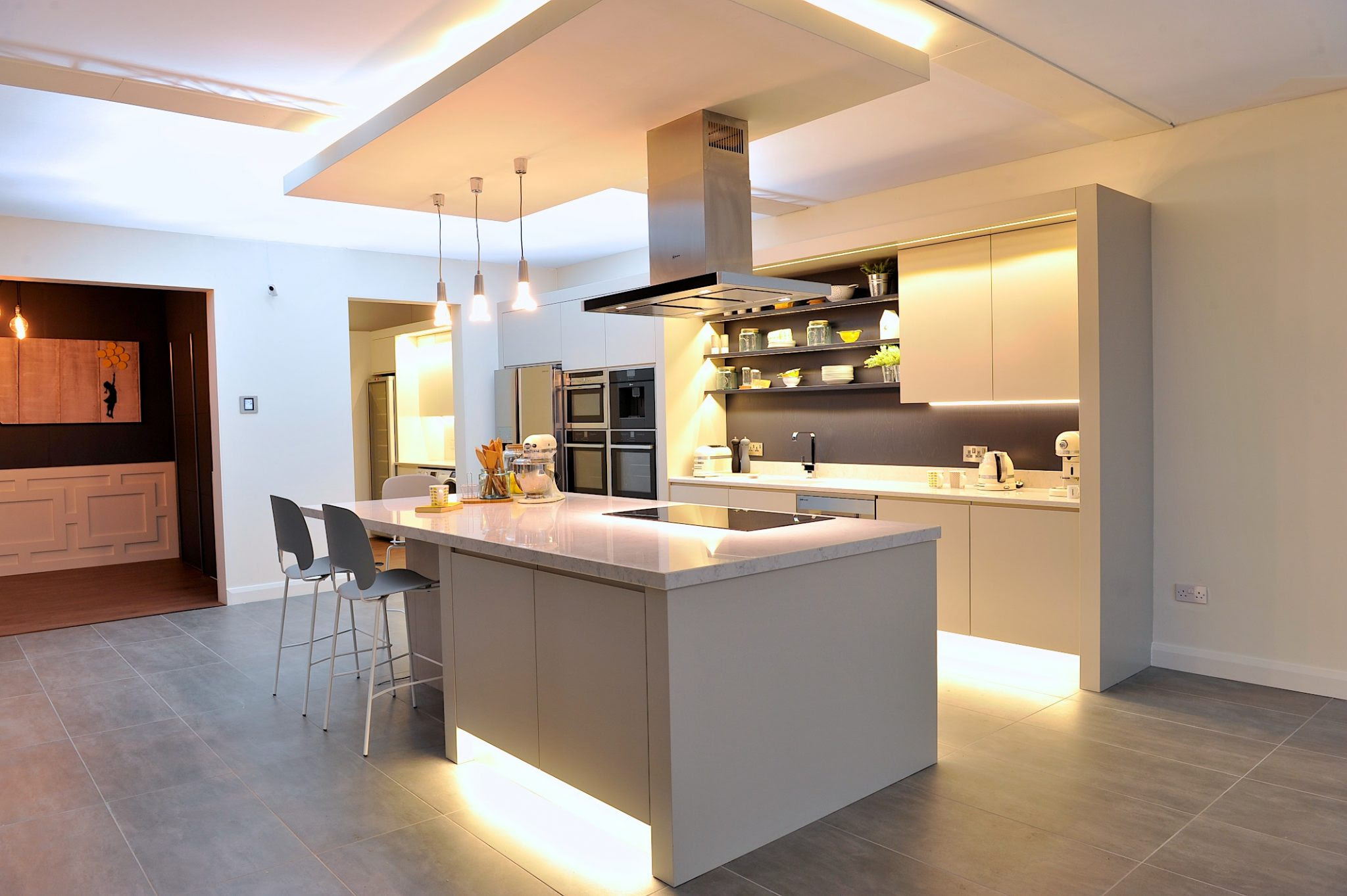 Modern show home kitchen with black granite worktops Stock ...