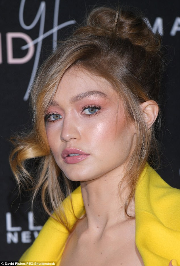Taking centre-stage:Opting for an early Noughties make-up palette, she framed her eyes with iridescent bronze shimmer and plumped her pout with glossy taupe lipstick