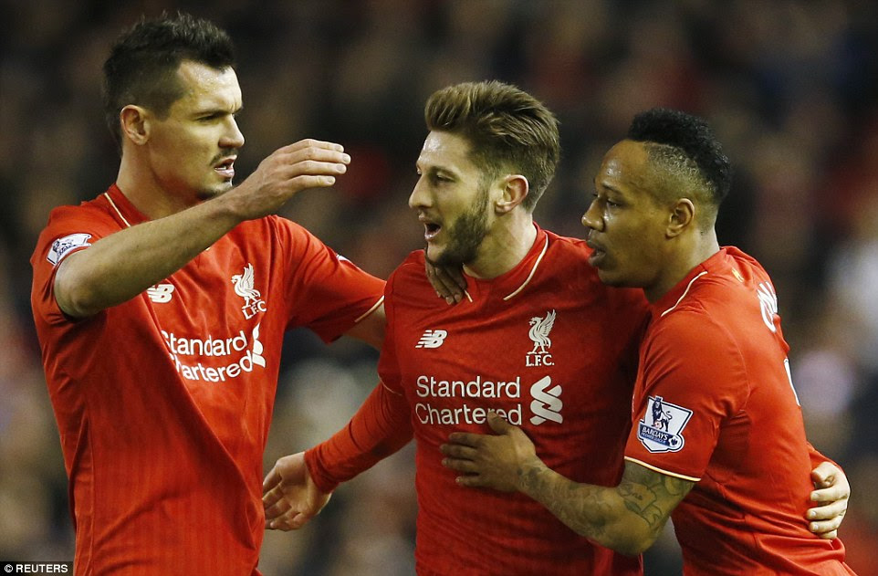 Lallana is congratulated by defenders Dejan Lovren and Nathaniel Clyne after putting Liverpool ahead ten minutes before the interval