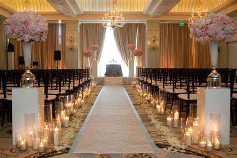 warm romantic wedding ceremony with gazebo and pillars