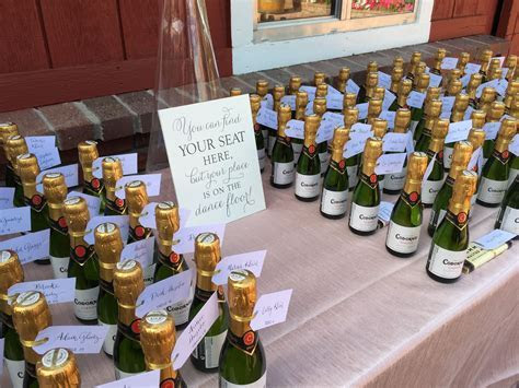 Mini Champagne bottles as escort cards with cute sign
