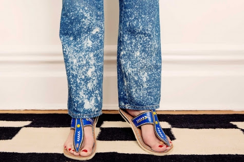 Close up on the denim's cool bleach spots, and Jane's Malian sandals.