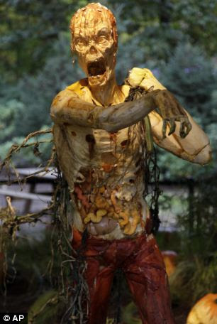 An upright zombie carved from giant pumpkins