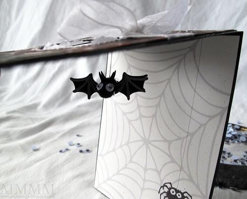 dangling bat inside window card