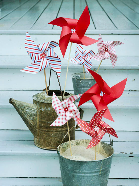 red, white and blue pinwheels in rustic buckets