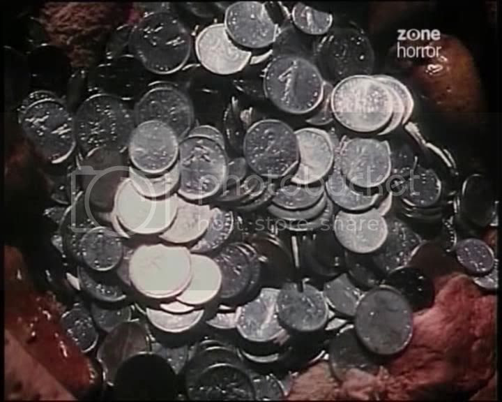 his stomach was filled with silver coins