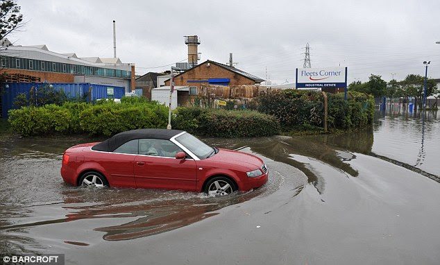 An industrial estate is flooded in POOLE, Dorset, after the River Bourne broke its banks