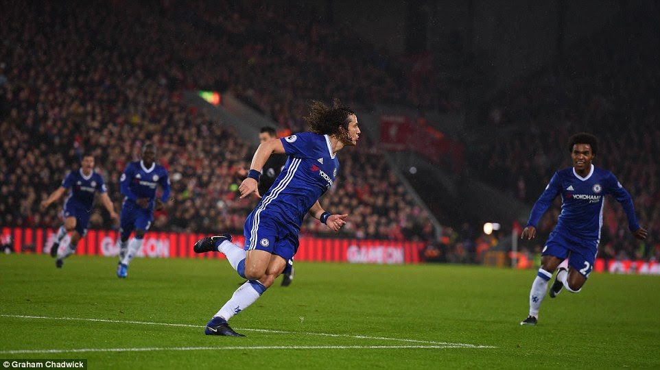 Luiz wheels away in delight and is soon chased down by his Blues team-mates after giving the west Londoners the lead