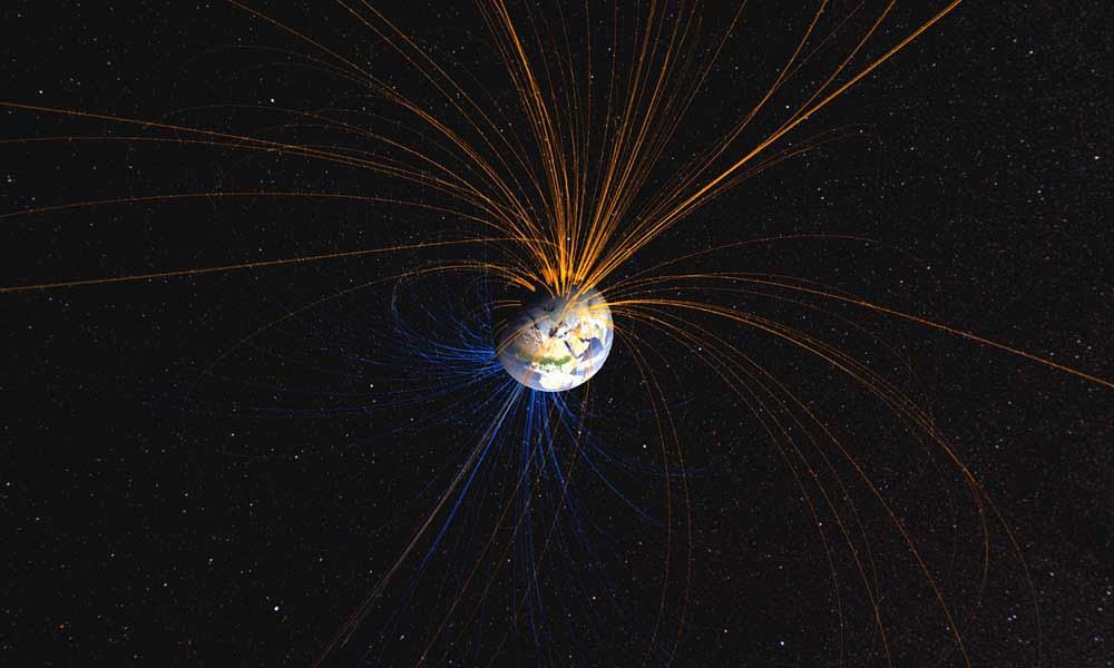 Earth's magnetic field connects the North Pole with the South Pole in this NASA-created image.