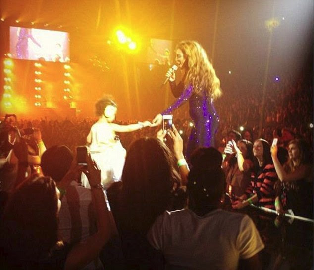 Taking the spotlight: Beyoncé brought her daughter Blue Ivy on stage on Saturday during a performance at the O2 Arena in London