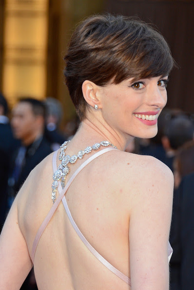 Actress Anne Hathaway (dress detail) arrives at the Oscars at Hollywood & Highland Center on February 24, 2013 in Hollywood, California.