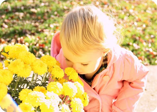 Eva smelling flowers