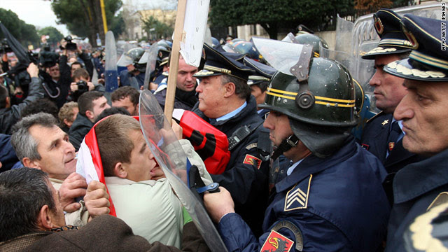Albanian demonstrators clash with riot police during an anti-government protest in Tirana on January 21, 2011.