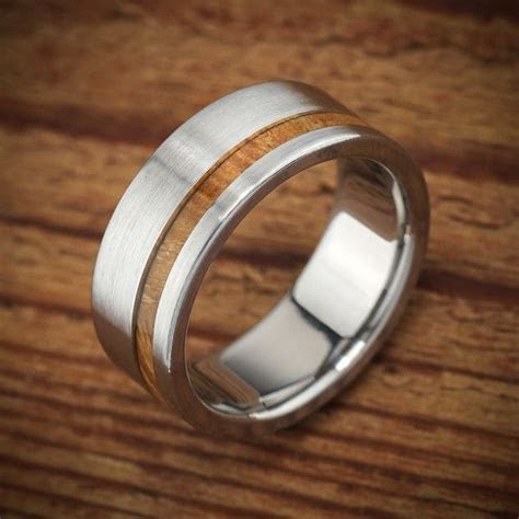 Mens wood wedding band in titanium by Spexton.   Men's