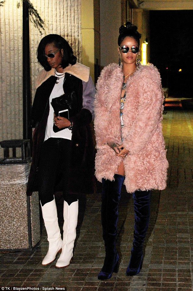 All dressed up: The star showed some leg in a pair of tiny denim shorts teamed with some seriously sexy over-the-knee velvet boots and topped off with a fluffy pink coat as she walked with her pal Melissa Forde