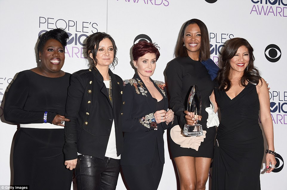 Laughing it off: Sheryl, Gilbert, Sharon, Aisha Tyler and Julie Chen looked to be in good spirits as they posed with their gong backstage