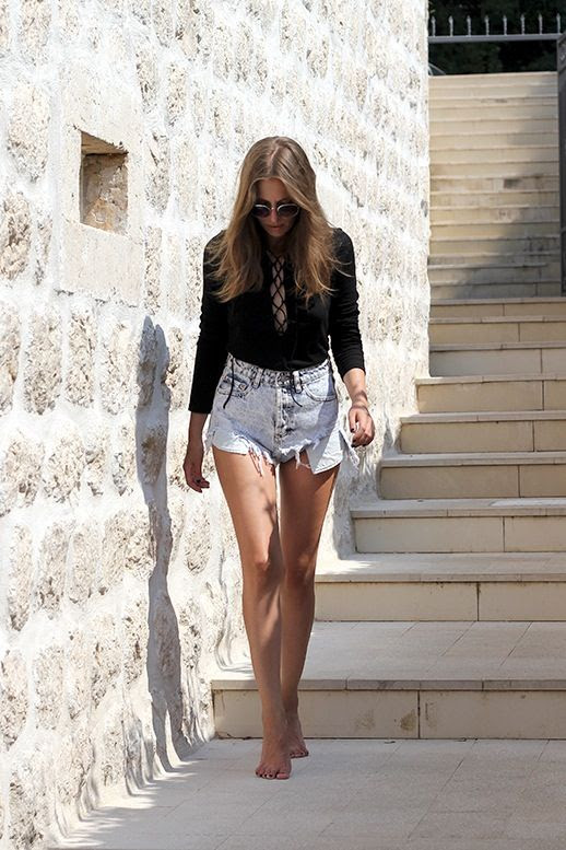 Le Fashion Blog Blogger Vacation Style Sunglasses Black Lace Up Top Acid Wash Cut Off Shorts Via Fashion And Style By V