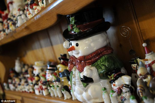 Meet Mr Frosty and his many friends: The staggering squadrons of snowmen dominate her kitchen, lounge and stairs