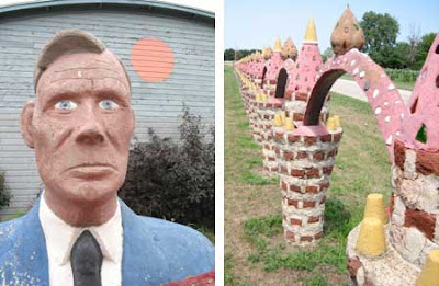 Concrete bust of a man in a blue suit, expressionless, and arch sculpture fading to the vanishing point